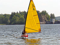 Punt with windsurf sail